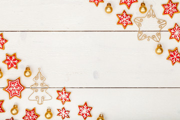 frame made of homemade christmas gingerbread cookies on white wooden background with copy space for text. holiday, celebration and cooking concept. new year and christmas postcard
