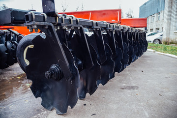 New modern agricultural disc harrow. Tillage equipment