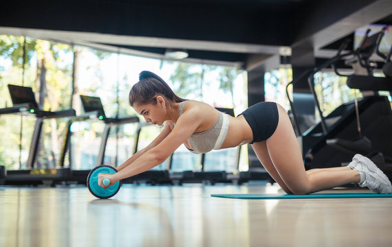 Woman with ab wheel