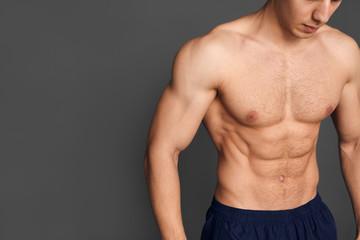 Crop sportive man posing shirtless