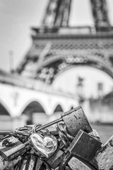 Love locks in Paris, Eiffel tower in the background - Black and white photography