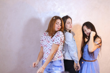 Funny girls pose in camera with smiles on their faces and stand