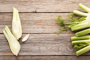 Ripe fennel bulbs on grey wooden table