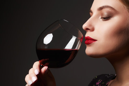 Beautiful young woman with wine