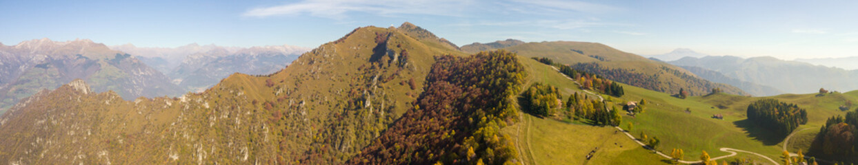 4K Drone aerial view to the Orobie Alps and Formico pick in a clear and blue day. Panorama at Farno Mountain, Bergamo, Italy.