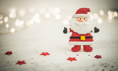 Santa on blurred lihts background, holiday concept