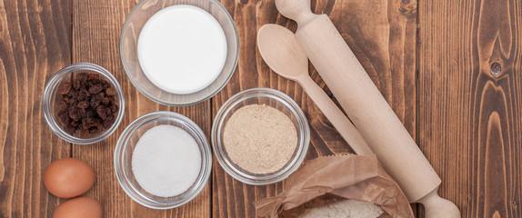 Ingredients for biscuits cake on vintage rural wood kitchen table