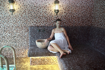 Woman sitting in hammam