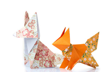 Two origami foxes. Cute designed paper figurines of animals. Folding paper with fun and creative.