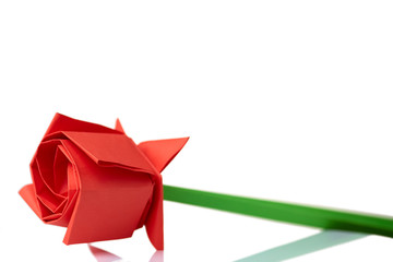 Red rose origami model. Paper folding, hand crafting project. Child's gift for mother.