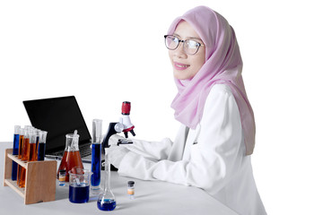Muslim scientist smiling at the camera