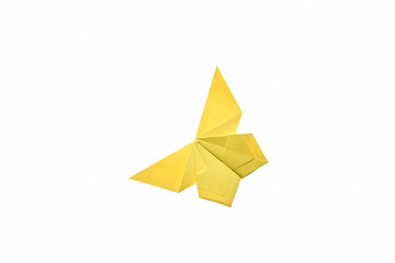 Yellow butterfly origami ornament, isolated on white. Beautiful result of folding paper. Cute and easy hand crafting project for kids.