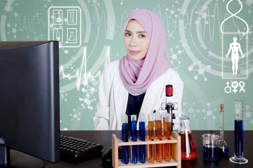Muslim doctor with green virtual screen