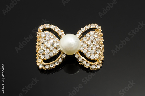 ddca58b2c54bc gold brooch bow with pearls and gems isolated on black
