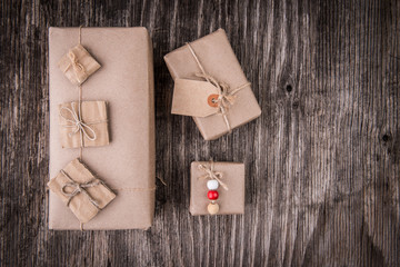 Creative gift boxes over rustic wood