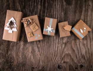 Boxes of gifts in natural paper rustic wooden table