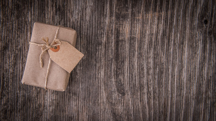 Mockup with handmade gift box on rustic wood
