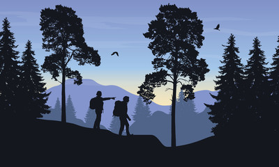 Vector illustration of a mountain landscape with a forest and two tourists, man and woman with backpacks showing his hand and looking into the distance under sky