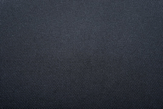 Texture of black woven synthetic waterproof fabric