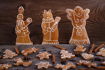Christmas homemade gingerbread cookies - devil and angel on wooden background
