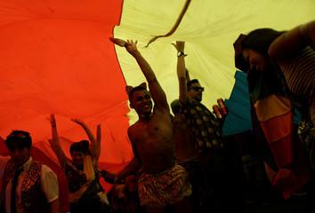 Revellers take part in the Gay Pride Parade at the Copacabana beach in Rio de Janeiro
