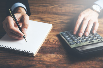 Hands of accountant business man with calculator