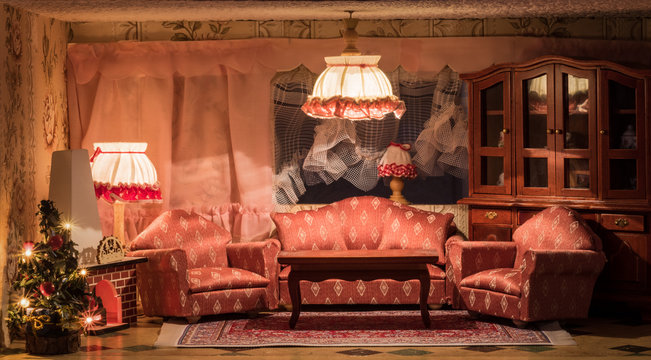 A dollhouse living room at christmas time