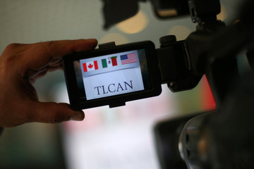 A NAFTA logo is seen on the viewfinder of a camera during the fifth round of NAFTA talks involving the United States, Mexico and Canada, in Mexico City