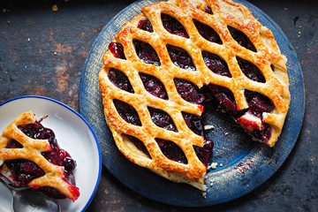Lattice autumn fruit pie, with blackcurrant, blackberry, cherry compote in puff pastry pie