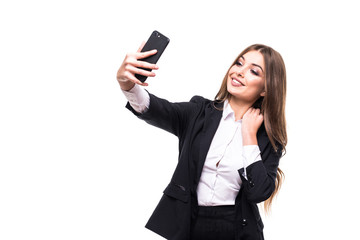 Closeup of beautiful playful business woman making selfie photo on white background and looking at camera