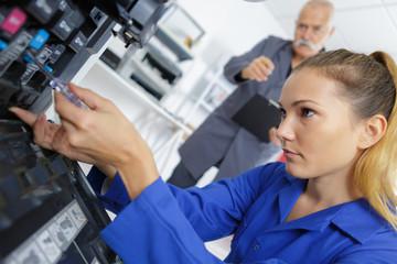 apprentice fixing a machine