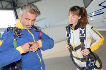 Parachutists securing harness