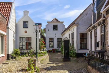 Street view with typical houses and architecture in Den Burg, village on the wadden island Texel. Wall mural