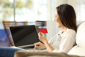 Woman paying on line with a credit card