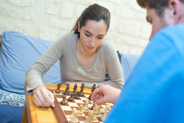 young people playing chess