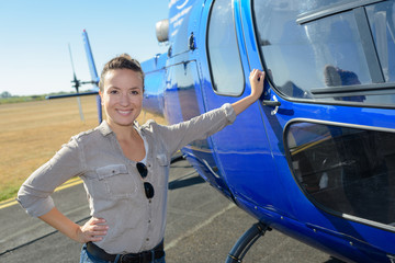 female tourist next to helicopter