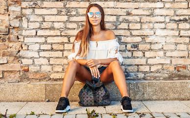 Street portrait of stylish girl in sunglasses