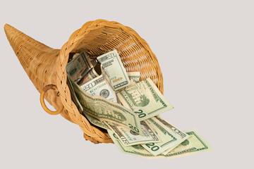 Cornucopia overflowing with U.S. twenty dollar bills with a shallow depth of field and copy space