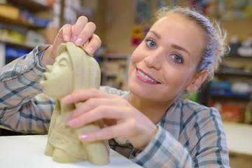 Female artist working on scupture