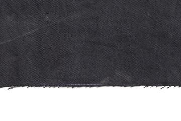 Black denim jeans torn leg close up