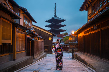 Wall Mural - Asian woman wearing japanese traditional kimono at Yasaka Pagoda, Kyoto, Japan