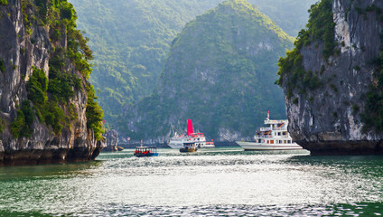 Dragon boat Ha Long bay green island Halong mountains, Vietnam.
