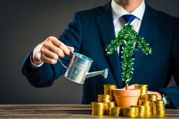 ビジネスマンと植物