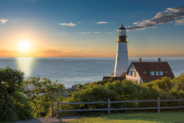 Magical sunrise at the iconic Portland Head Light. Portland, Maine