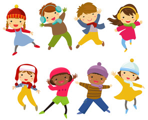 Happy children jumping - winter
