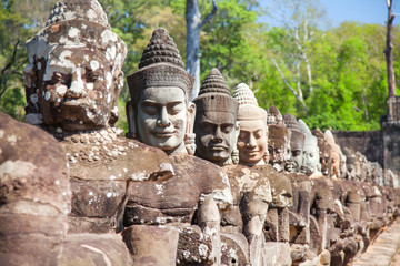 Stone heads guards South Gates of Angkor Thom, Siem Reap, Cambodia