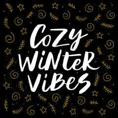 Canvas Prints Christmas Cozy winter vibes - trendy brush hand lettering isolated on black background with gold holiday elements. Greeting card for the winter season. Vector illustration.