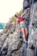 girl climbs the rock