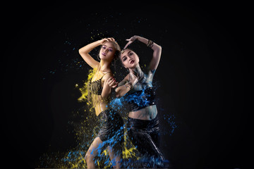 Portrait of two asian belly dancer perform with colorful paint