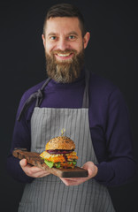 Smiling Man holding tray with chicken burger.